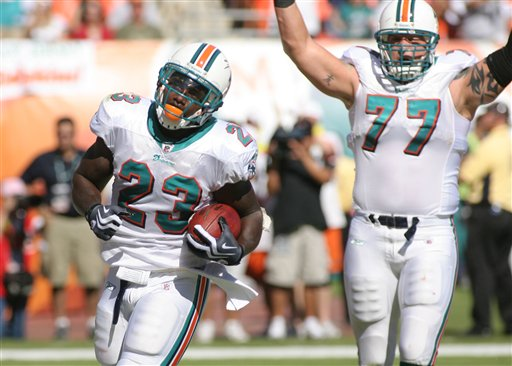Ronnie Brown (left), Jake Long (right)